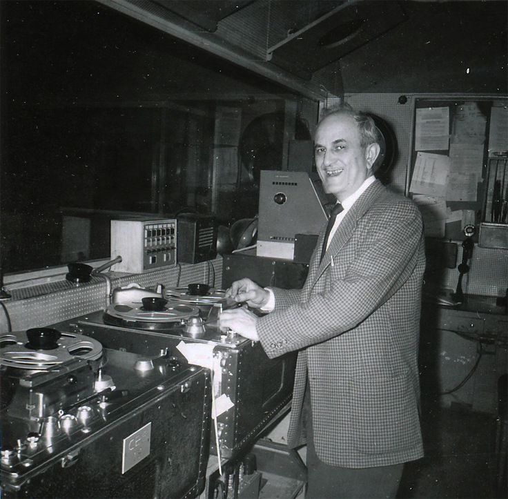 Joel Tall with Ampex tape recorders who creatd the tape splicer Editall used around the world. Photo of Joel Tall  donated by his daughter, Benita Kaplan to the Museum of Magnetic Sound Recording