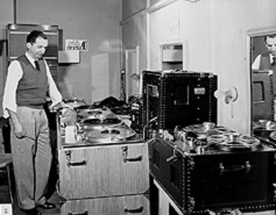 "John ""Jack"" Mullen with early Ampex 200-As in both console and portable cases."
