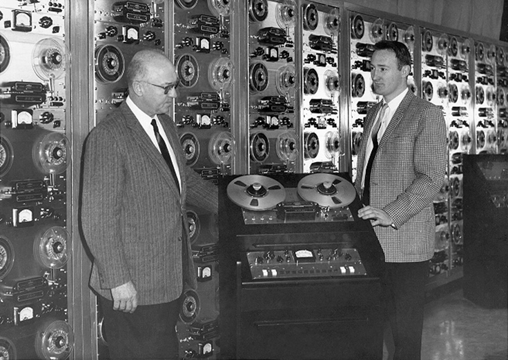 Clarence Moore and his son with numerous Crown reel to reel tape recorders
