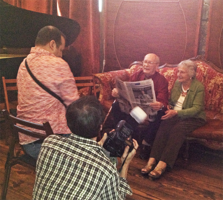 Blue Rock Studio's Neve 5088 dedication photo showing Josh, Evelyn and Rupert looking at the Austin American Statesman article - photo is in the Reel2ReelTexas.com vintage reel tape recorder recording collection