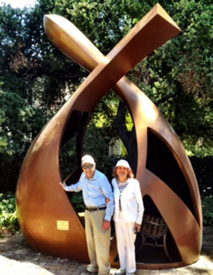 "Esther and Robert Metzner with the sculpture ""Convergence"""
