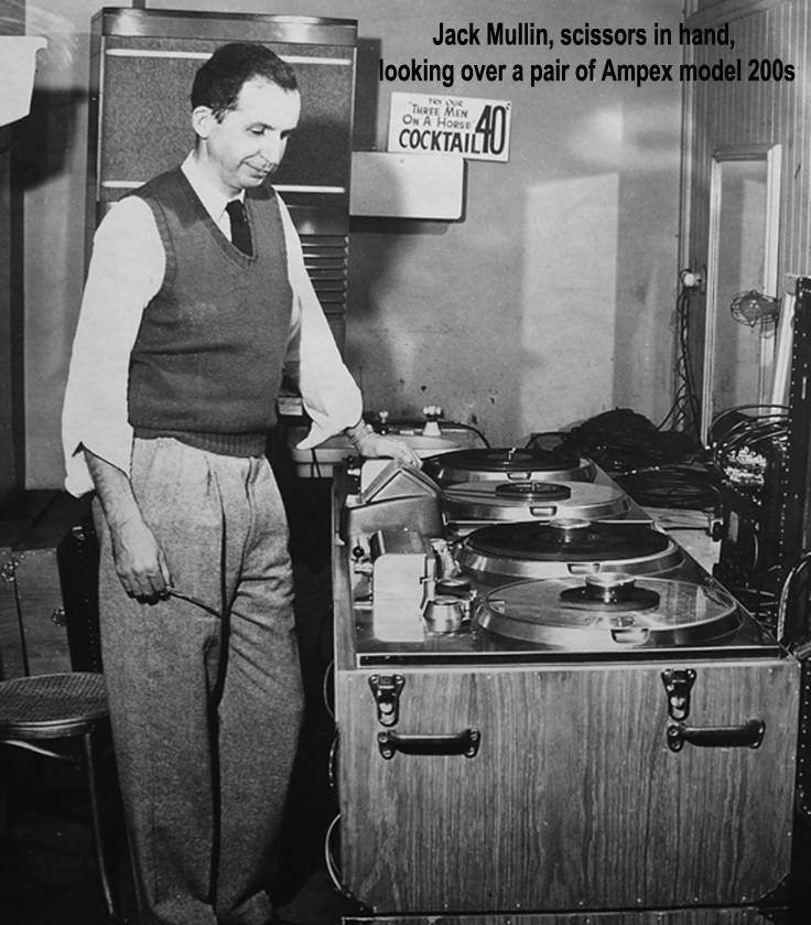 "John ""Jack"" Mullin shown with editing sissors in hand beside early Ampex 200A professional reel to reel tape recorders in the Museum of Magnetic Sound Recording"